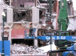closeup of worker as demolition of Schenectady's IOOF Hall continues - 31Jan2012